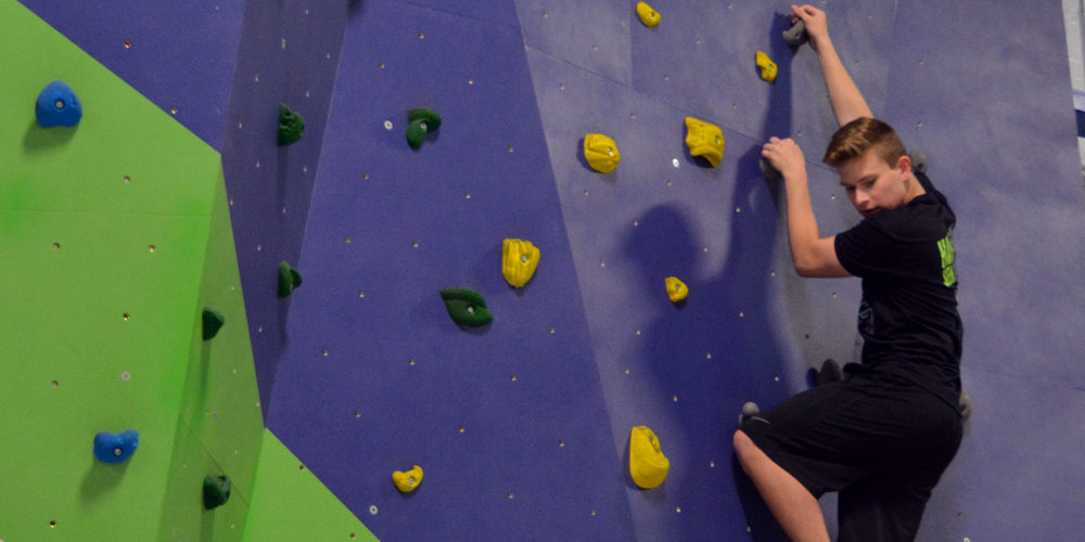 Teen on climbing wall